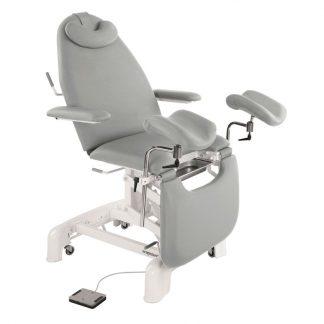 Elektrisk gynækologisk behandlingsstol med armlæn, pude og hjul